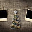 Old style photographs and Christmas tree hanging on a clotheslin — Stock Photo