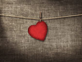 Valentine card heart shaped from old red paperr hanging on a clo — Stock Photo