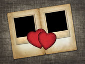 Two old-style photo with red paper hearts — Stock Photo