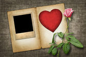 Old-style photo with red paper heart with pink rose — Stock Photo