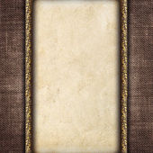 Vintage card in a carved frame on fabric background — Zdjęcie stockowe