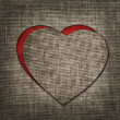 Stock Photo: Heart of linen fabric with red substrate