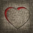 Heart of linen fabric with red substrate — Stock Photo #39353859