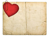 Old paperboard card with red paper heart — Stock Photo