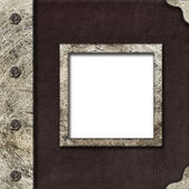 Cloth album cover with an iron rootlet and frame for photo — Stock Photo