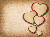 Vintage floral background with paper hearts — Stockfoto