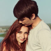 Summer outdoors portrait of young sensual couple — Stock Photo