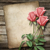 Old vintage card and a bouquet of pink roses — Stock Photo