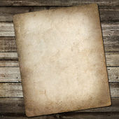 Old vintage card on grungy wooden background — Stock Photo