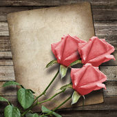 Old vintage card and a bouquet of pink roses — Stockfoto