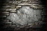 Stone wall with a large hole in the middle — Stock Photo