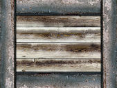 Wooden background framed by old painted boards — Stock Photo