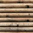 Grungy background of cylindrical logs — Stock Photo #48597327