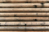 Grungy background of cylindrical logs — Stock Photo