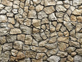 Old grunge wall of rough stones as background — Stock Photo