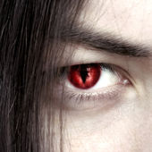 Face of a young male vampire close up — Stock Photo