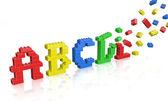 Colorful brick toys alphabet — Stock Photo