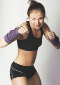 Young attractive woman showing boxing motion — Foto Stock