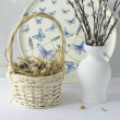 Stock Photo: Quail eggs in a basket and willow branches