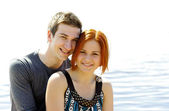 Portrait of a young beautiful happy couple outside — Foto Stock