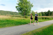 Young couple running outside — Стоковое фото