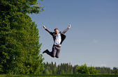 Young man jumping outside — Stock Photo