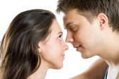 Young man and woman looking for tenderness and closeness — Stock Photo