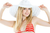 Portrait of pretty cheerful woman wearing red swimsuit and straw hat in sun — Stock Photo