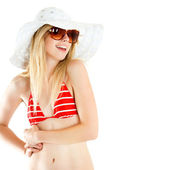 Portrait of pretty cheerful woman wearing red swimsuit and straw hat in sunny warm weather day — Stock Photo