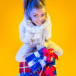 Christmas Woman. Beautiful New Year and Christmas Gift Holiday H — Stock Photo #37177531