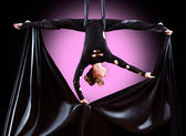 Beautiful dancer on aerial silk, aerial contortion, aerial ribbons, aerial silks, aerial tissues, fabric, ribbon, tissue — Stockfoto