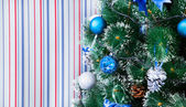 Christmas background of de-focused lights with decorated tree — Stock Photo
