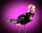 Circus actor standing on the hand on a purple background — Stock Photo