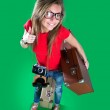 Woman traveler with a camera, green background — Stock Photo #43653387