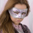 Portrait of a beautiful girl in a mask — Stockfoto