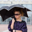 Portrait of a beautiful girl with an umbrella — Stockfoto