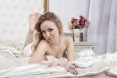 Girl lying on the bed — Foto Stock