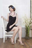 Portrait of beautiful girl sitting on a chair — Stock Photo