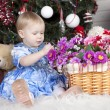 Little girl surrounded by flowers — Stock Photo