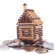 House made of matches is on the hill of coins — Stock Photo