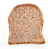 Slice of crusty bread — Stock Photo