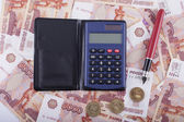 Business still-life. Money, pen and calculator — Stock Photo