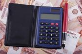 Business still-life. Money, pen and calculator — Stock Photo