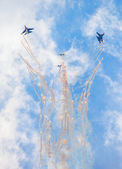 "Aerobatic team ""Swifts"" in the sky at an air show at the International Maritime Defense Show IMDS-2013, St. Petersburg — Stock Photo"