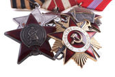 Awards of the USSR. Orders of the Great Patriotic War 1st and 2nd degree and the Order of the Red Star on the background of the St. George's Ribbon — Stock Photo