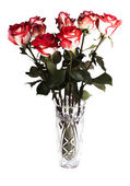 Bouquet of roses in a crystal vase isolated on white background — Stock Photo