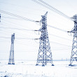 Electrical tower structure in the snow — Stock Photo