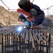 Stock Photo: Worker is welding work in a construction site