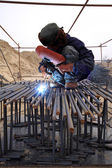 Worker is welding work in a construction site — Stock Photo