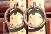 Knockers on the iron plate — Stock Photo